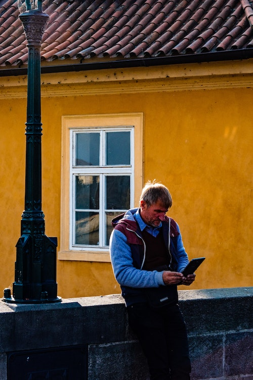 A man ooking at a tablet on the bridge